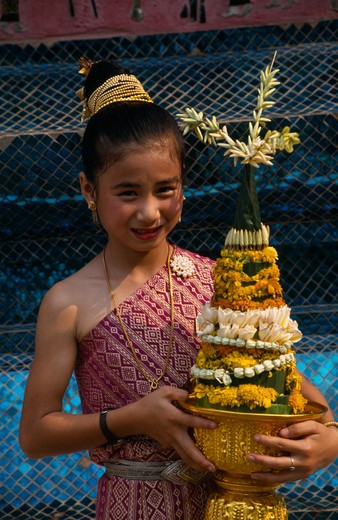 Laos, Luang Prabang, Young Girl In Traditional Dress With Flower Offering At New Year Celebrations. : Stock Photo