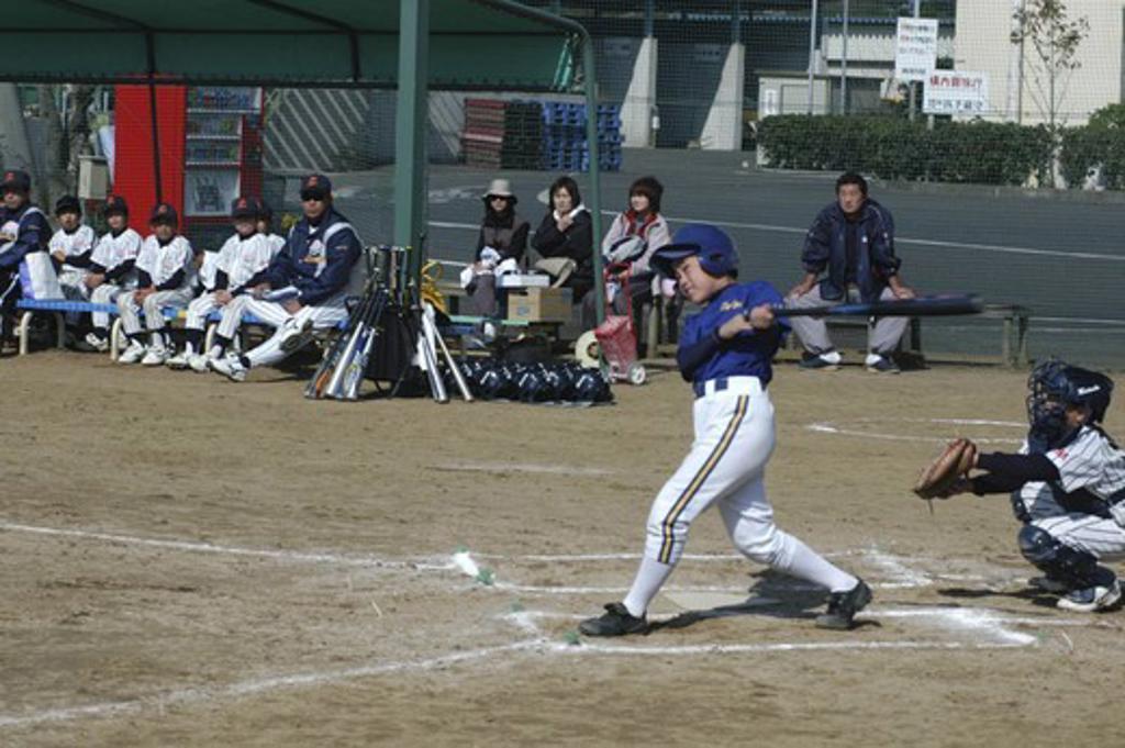 Japan, Chiba, Tako, 'Captain Toshiki Hagiwara, 12 Year Old 6Th Grader,  Watches The Ball Go For Toujou Shonen Yakyu Club, Youth League Baseball ' : Stock Photo