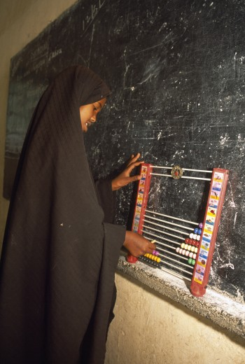 Stock Photo: 1850-12622 Somaliland, Hargeisa, Ali Osman Primary School.  Girl Using Abacus In Classroom.