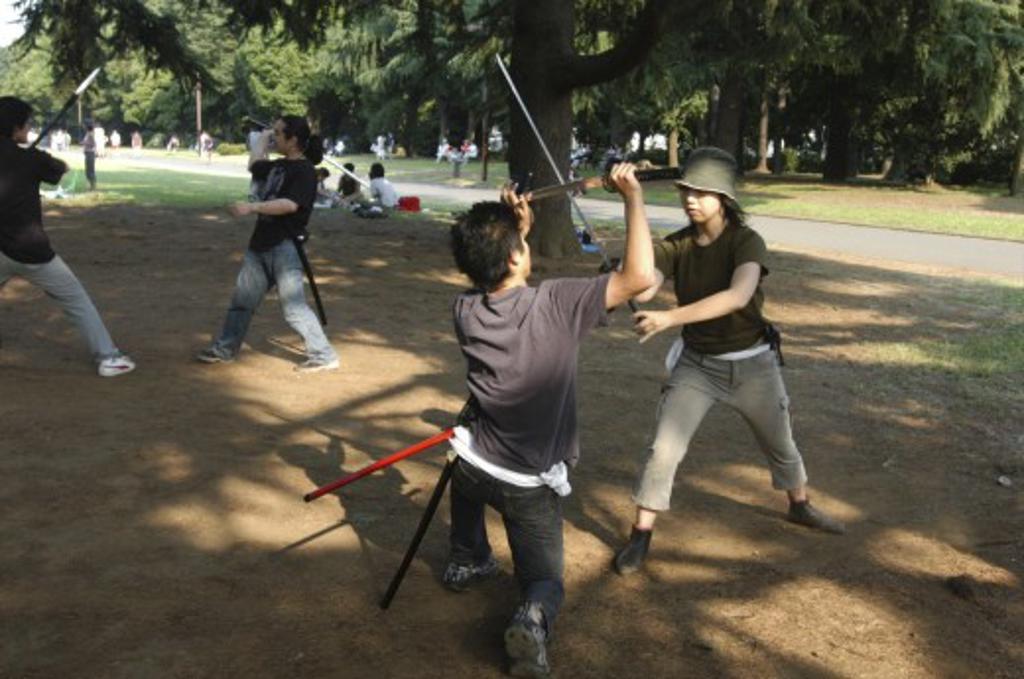 Japan, Honshu, Tokyo, 'Harajuku. Yoyogi Park On Saturday Afternoon, Miyuki Wada Aged 31 And Takaki Hagi Aged 20, Practice Sword Fighting For Ichigaya Tanabata Festival' : Stock Photo