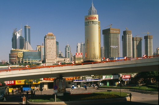 China, Shanghai, 'View Of Pudong From The Bund.  Elevated Roadway, Shops And Skyscrapers.' : Stock Photo