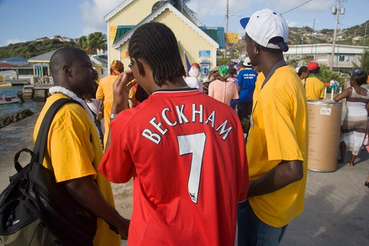 West Indies, St Vincent & The Grenadines, Union Island, Men Of The Baptist Congregation In Clifton At Easter Morning Harbourside Service For Those Lost At Sea With One Wearing A Beckham Football Shirt : Stock Photo