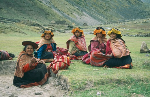 Peru, Cusco, Cancha Cancha, 'Local Quechuan Women Sat On Grass, Wearing Traditional Dress.' : Stock Photo