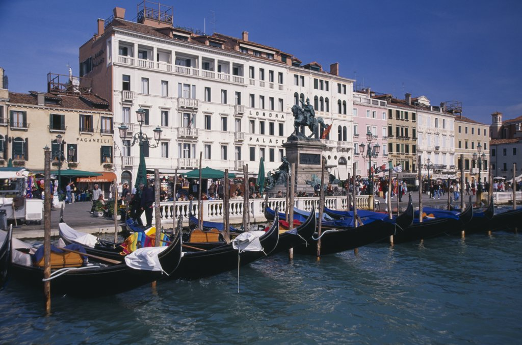 Stock Photo: 1850-15314 Italy, Veneto, Venice, Gondolas Moored Against The Riva Degli Schiavoni With The Londra Palace Hotel Behind.
