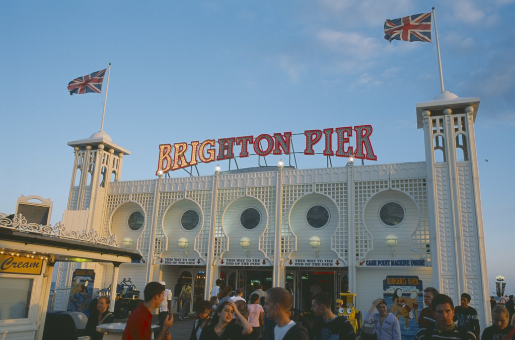 England, East Sussex, Brighton, Brighton Pier With Groups Of People In The Foreground. : Stock Photo