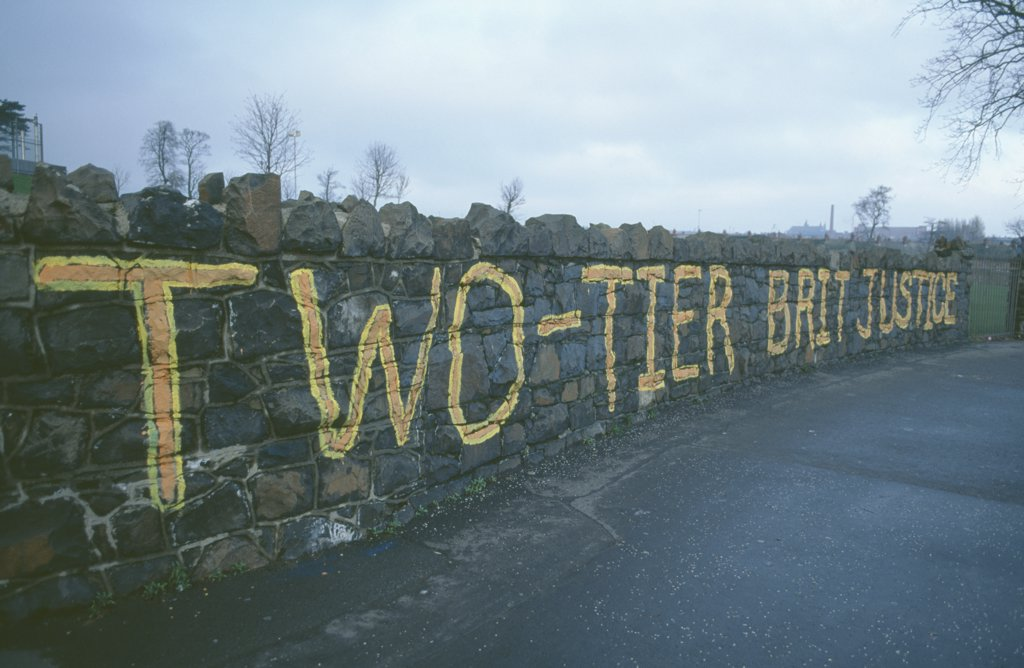 Ireland, North, Belfast, Falls Road. Beechmount Area. Anti British Grafitti On A Wall Saying Two Tier British Justice : Stock Photo