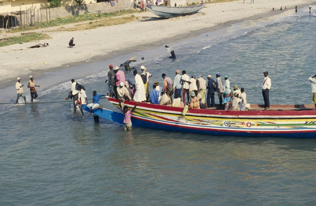 Gambia, Banjul, Busy Local Ferry Arriving Into Shore : Stock Photo