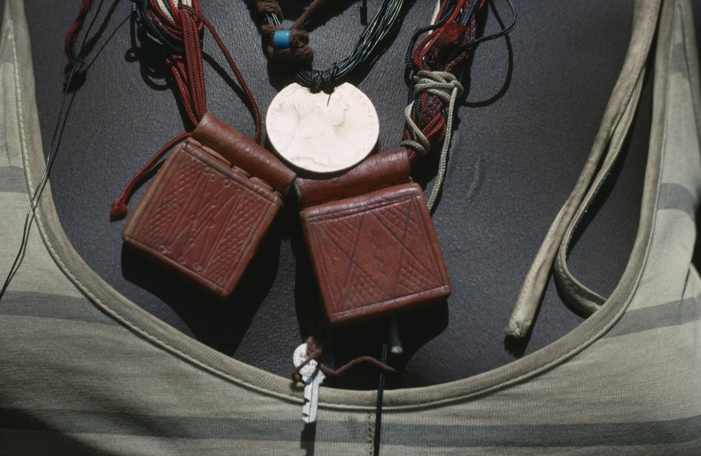 Sudan, Mornei Settlement, Close View Of Leather Pouches Containing Verses Of The Koran Worn Around The Neck As A Charm By Chadian Refugee Woman Together With Old French Coin And Beads. : Stock Photo