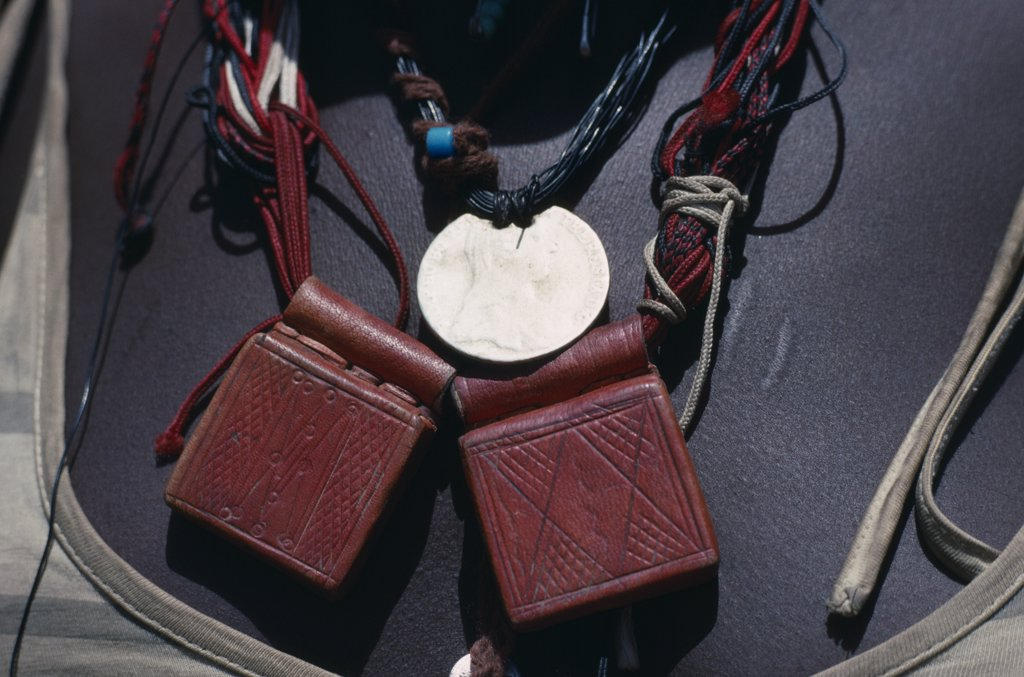 Stock Photo: 1850-16666 Sudan, Mornei Settlement, Close View Of Leather Pouches Containing Verses Of The Koran Worn As A Charm Around The Neck By Chadian Refugee Woman Together With Old French Coin And Beads.