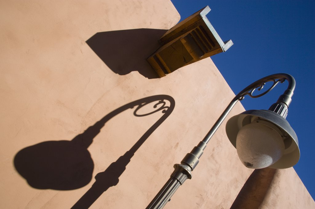 Usa, New Mexico, Santa Fe, Street Lamp And Gutter Detail With Shadows On Adobe Style Building : Stock Photo
