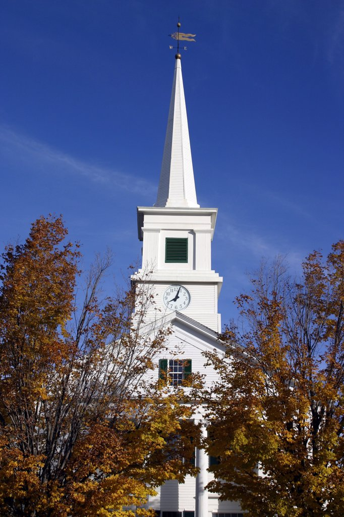 Stock Photo: 1850-17235 Usa, New Hampshire, Dublin, 'Close Up Of White Church With Clock On Spire And Tall Columns At Entrance,  Golden Leaves On Trees.'