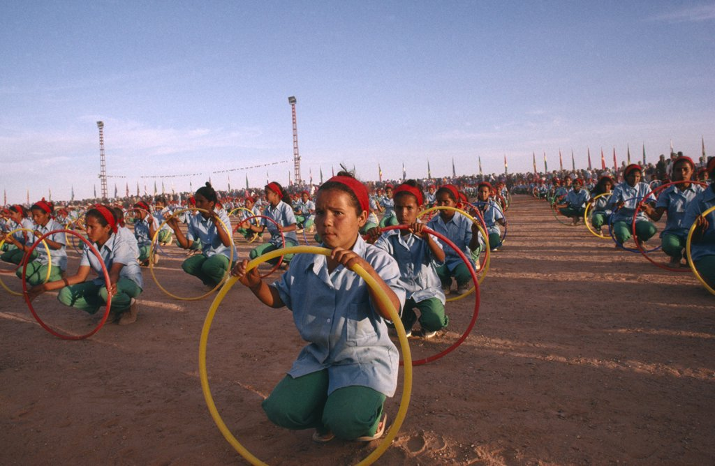 Stock Photo: 1850-17385 Western Sahara, Sadr, 'Parade Of Children With Coloured Hoops Celebrating Anniversary Of The Polisario Front, The Sahrawi Movement Working Towards Independence.'