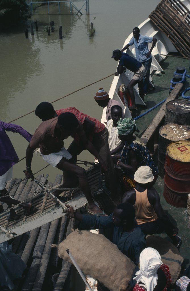 Gambia, Transport, People Boarding Boat On The River Gambia. : Stock Photo