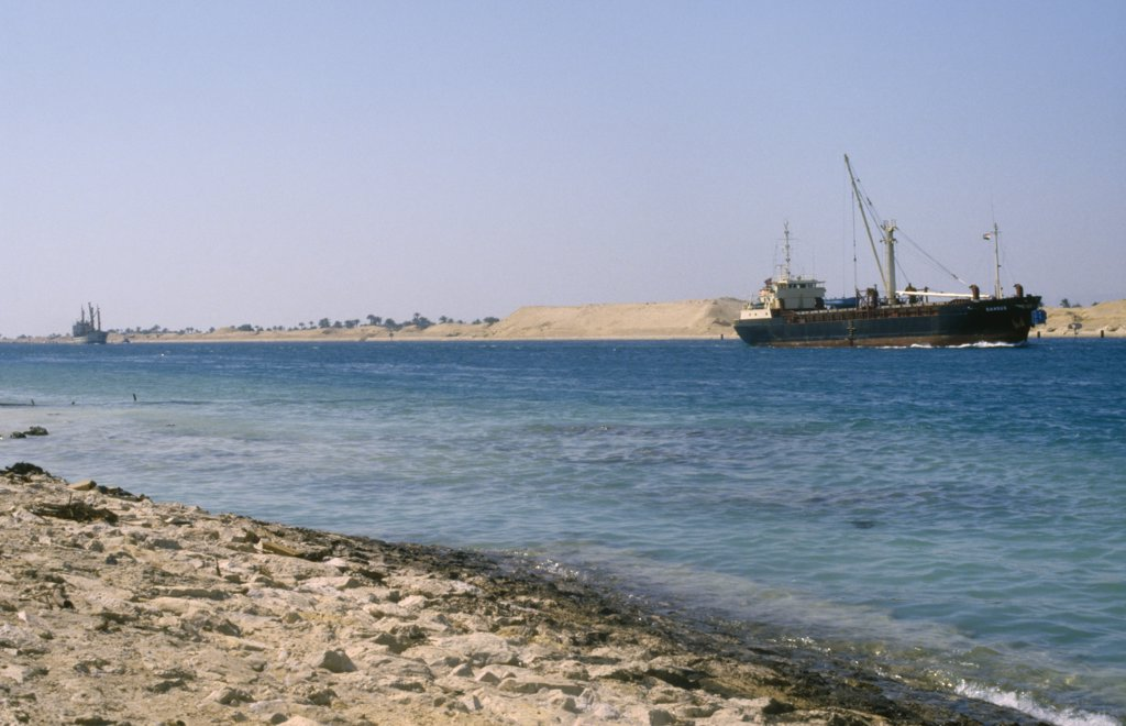Stock Photo: 1850-17577 Egypt, Transport, Container Ship On The Suez Canal.