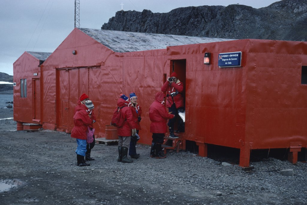 Antarctica, King George Island, Teniente Marsh Station. Tourists Wearing Red Jackets Outside Post Office : Stock Photo