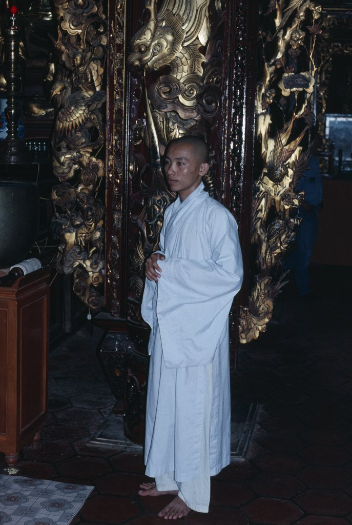 Stock Photo: 1850-18170 Vietnam, Mekong Delta, My Tho, Monk Wearing White Robes In Vinh Trang Pagoda