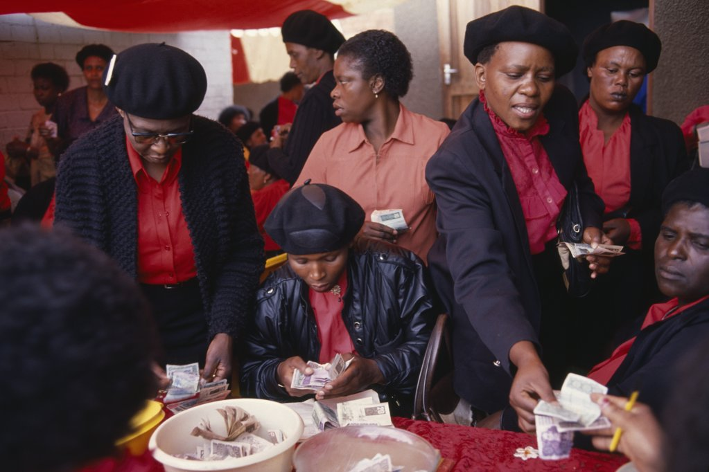 Stock Photo: 1850-18337 South Africa, Gauteng, Alexandra Township, 'Female Members Of Burial Society Or Stokvel Counting Money.  Funerals Are Seen As An Important Part Of Culture And Tradition And Are Costly, Often Lasting Several Days.'