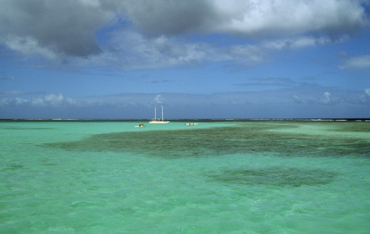 West Indies, Tobago, Buccoo Reef, The Nylon Pool With Yacht Anchored On The Horizon : Stock Photo