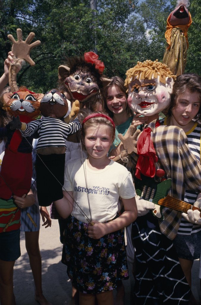 Stock Photo: 1850-18501 Russia , Children, Kids With Puppets At Summer Camp. The Camp Is A Former Prison.