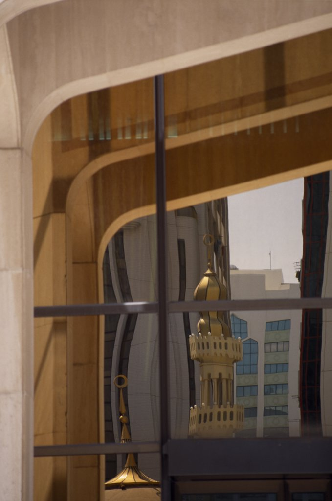 Stock Photo: 1850-19049 Uae, Abu Dhabi, Arabian Monetary Fund Head Office Building. Detail Of  Windows With Minarets And Tall Buildings Reflected In The Glass