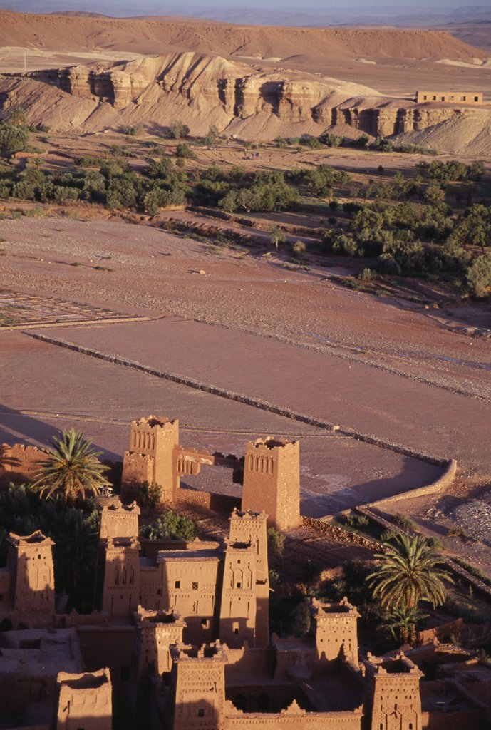 Stock Photo: 1850-19656 Morocco, Ait Benhaddou, Kasbah And Hill Town Used In Films Such As Jesus Of Nazareth And Lawrence Of Arabia.  Looking Down On Sandstone Buildings And Surrounding Landscape.