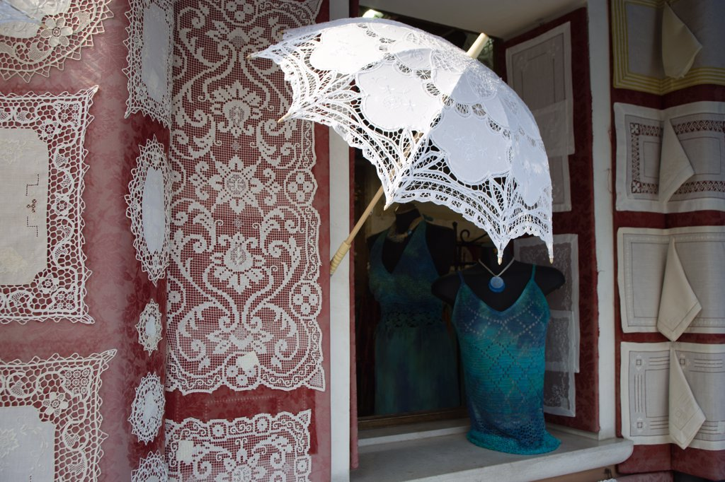 Italy, Veneto, Venice, 'Burano, One Of The Few Inhabited Islands In The Lagoon Famous For Traditional Lace Production. Shop Display Of Locally Made Lace' : Stock Photo