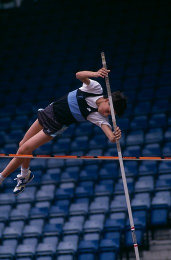 Sport, Athletics , Pole Vault, Competitor In Junior Athletics Championship At Crystal Palace Clearing Bar In Pole Vault. : Stock Photo