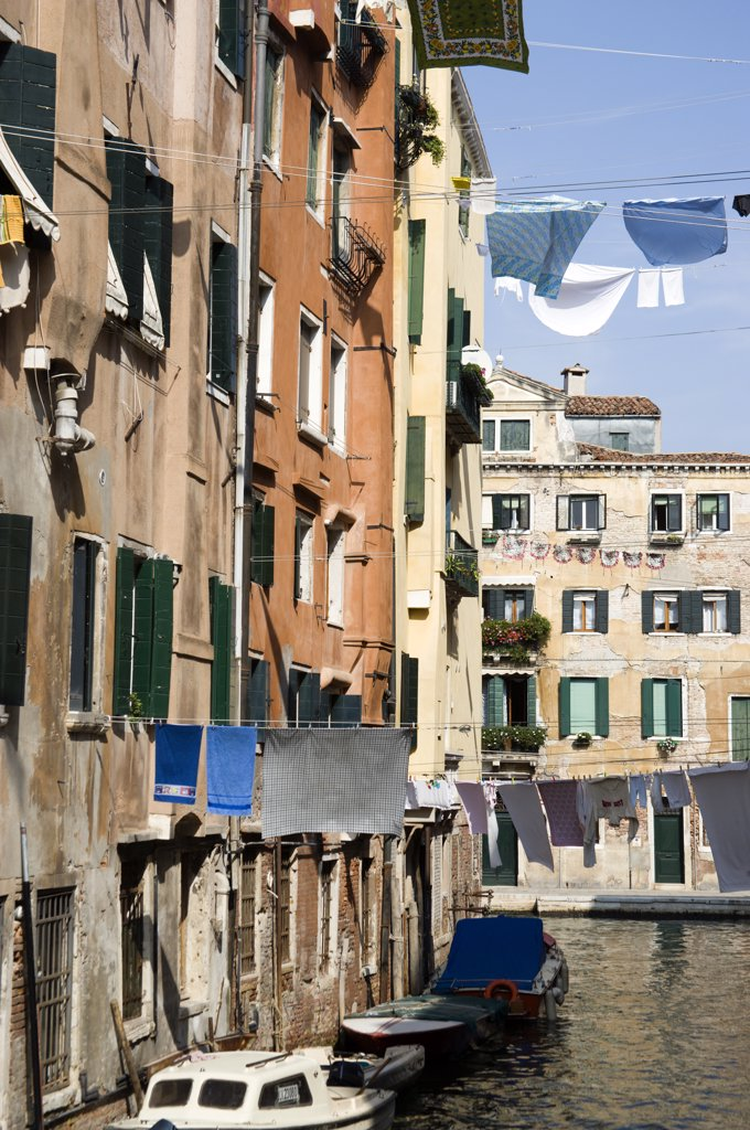 Italy, Veneto, Venice, Washing Hanging From Lines Above A Canal From Buildings In The Ghetto. The Worlds First Jewish Ghetto : Stock Photo
