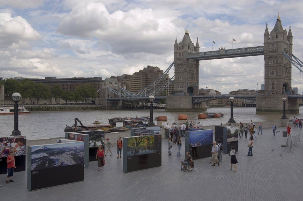 Stock Photo: 1850-20524 England, London, The Queens Walk Open Air Exhibition Outside The Gla City Hall With Tower Bridge Behind.