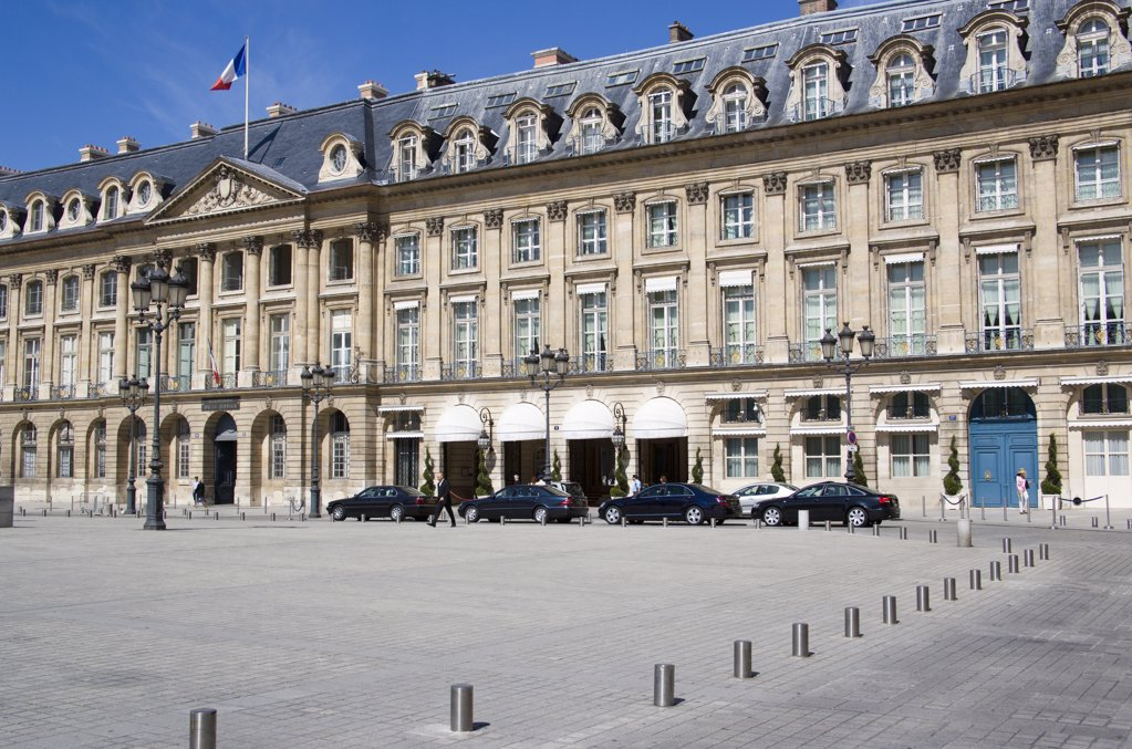 Stock Photo: 1850-21067 France, Ile De France, Paris, Limousines Parked At The Front Of The Ritz Hotel In Place Vendome With The French Tricolour Flying From A Flagpole Above The Ministry Of Justice Next Door