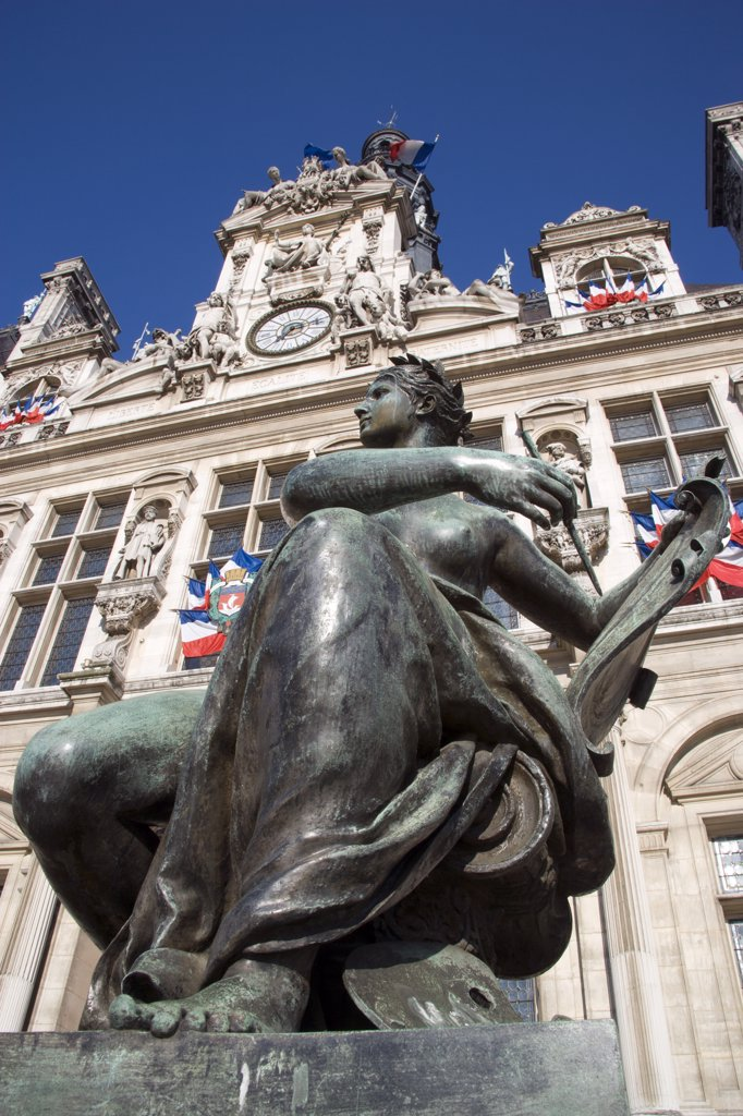 France, Ile De France, Paris, One Of Several Female Bronze Statues In Front Of The Hotel De Ville Town Hall Adorned With French Tricolour Flags : Stock Photo
