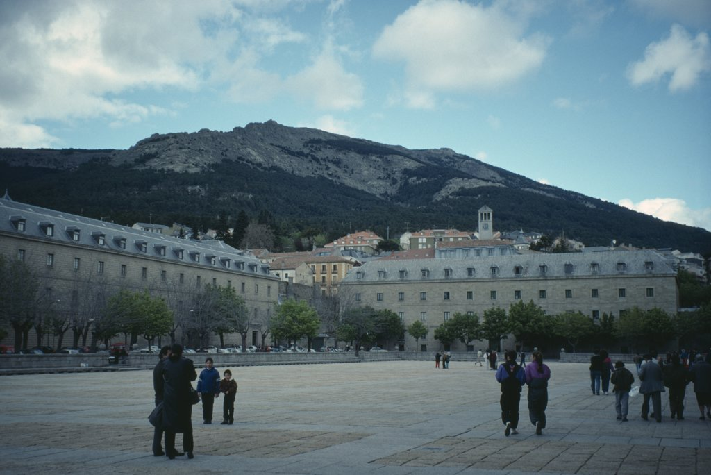Stock Photo: 1850-21274 Spain, Madrid, El Escorial, Royal Monastery Of San Lorenzo De El Escorial.  Sixteenth Century Palace And Monastery Built During The Reign Of Phillip Ii.  Exterior With Tourist Visitors In Foreground.