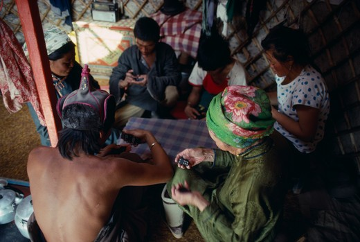 Stock Photo: 1850-21934 Mongolia, People, Playing Game Of Dominoes Inside Yurt.