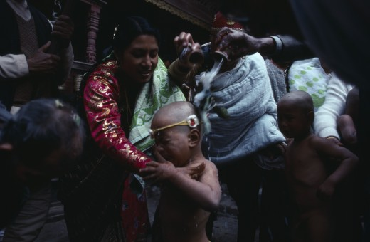 Stock Photo: 1850-21953 Nepal, Patan, Buddhist Priests And Family Bless Young Boy With Milk During His Bhartavan Or Manhood Ceremony.