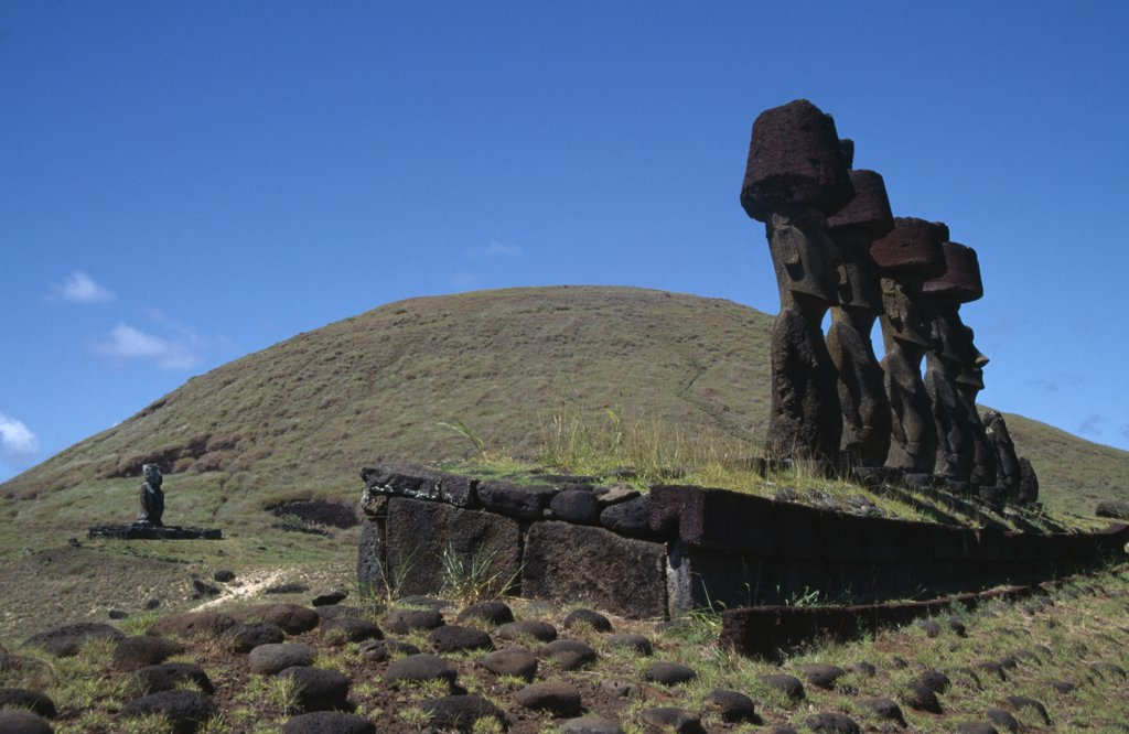 Stock Photo: 1850-22551 Chile, Easter Island, Anakena, Prehistoric Stone Heads Or Moai Carved From Volcanic Rock Or Tuff And Resting On Ahus Stone Burial Platforms Facing The Sea.