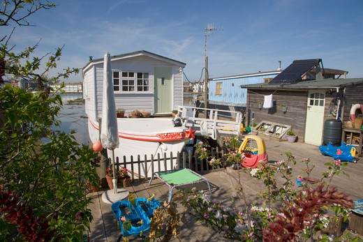Stock Photo: 1850-22679 England, West Sussex, Shoreham-By-Sea, Houseboat Moored Along The Banks Of The River Adur.  Former Barges And Old Boats Converted Into Homes .