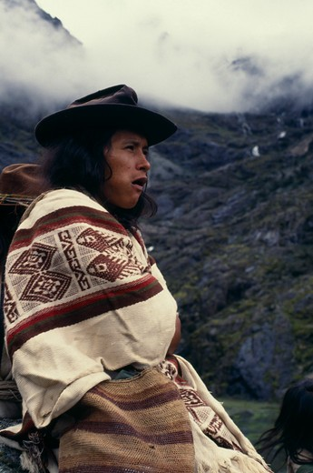 Colombia, Sierra Nevada De Santa Marta, Ika, Portrait Of Ika Shepherd Wrapped In Woven Wool&Cotton Manta Cloak  High In Sierra Nevada De Santa Marta. Arhuaco Aruaco Indigenous Tribe American Colombian Colombia Hispanic Indegent Latin America Latino South America  Arhuaco Aruaco Indigenous Tribe American Colombian Columbia Hispanic Indegent Latin America Latino South America Farming Agraian Agricultural Growing Husbandry  Land Producing Raising One Individual Solo Lone Solitary 1 Agriculture Sing : Stock Photo
