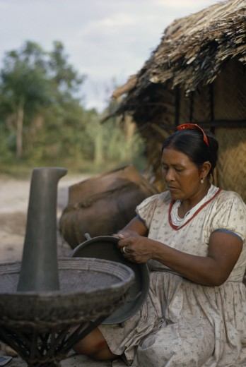 Colombia, North West Amazon, Tukano Indigenous People, Barasana Woman  Paulina  Headman Bosco'S Sister  Making Clay Cooking Pot. Note The Larger Fired Pot Behind Her. A Fine Potter Whose Death Has Marked The Virtual Extinction Of Pottery-Making Amongst The Barasana   Tukano Sedentary Indian Tribe North Western Amazonia American Colombian Columbia Female Women Girl Lady Hispanic Indegent Latin America Latino South America Tukano Female Woman Girl Lady One Individual Solo Lone Solitary : Stock Photo
