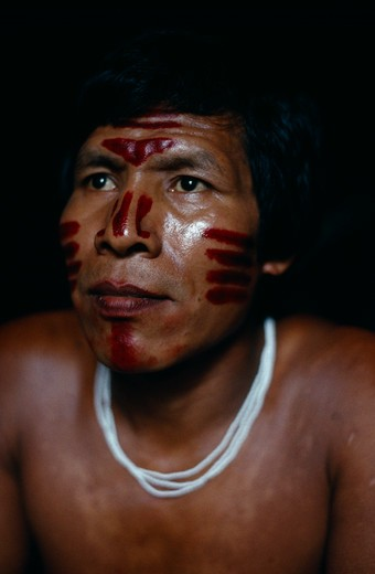Colombia, North West Amazon Vaupes Rio Piraparana, Tukano Indigenous People, Head And Shoulders Portrait Of Venancio Makuna  Ignacio'S Son  With Ceremonial Dark Red Achiote Facial Paint. Tukano Makuna Indian North Western Amazonia American Colombian Columbia Hispanic Indegent Latin America Latino Male Men Guy South America Tukano Vaupes : Stock Photo