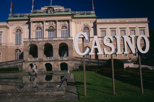 Stock Photo: 1850-23184 Austria, Salzburg, 'Klessheim Palace, Now The Salzburg Casino.  Baroque Exterior Dating From 18Th C. And Designed By Architect Fischer Von Erlach.  Lake, Statue And Sign For Casino.  '