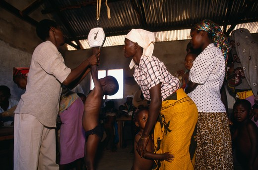 Kenya, Kibwezi, Children Being Weighed In Mobile Clinic. : Stock Photo