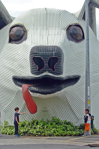 New Zealand, North Island, Waikato, 'Tirau, A Corrugated Iron Sheepdog Which Is The Towns Tourist Informnation Centre Off Main Street In Tirau Town, South Waikato, North Island. Built In 1998 At Night The Dogs Eyes And Nose Light Up.' : Stock Photo