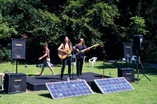 Stock Photo: 1850-24024 England, East Sussex, Lewes, Guitar Festival Performers With Solar Powered Amplifier Systems.