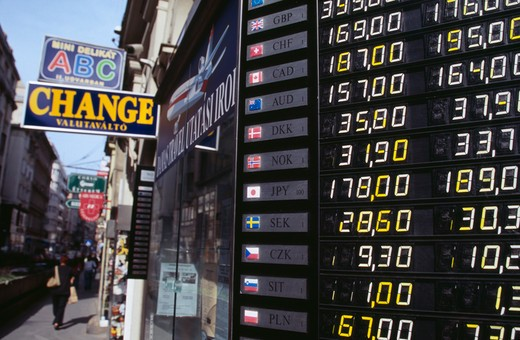 Stock Photo: 1850-24034 Hungary, Budapest, Exchange Rates Listed Outside Shop Offering Money Changing Service.