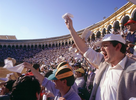 Stock Photo: 1850-2418 Spain, Andalucia, Seville, 'Arenal District, White Handkerchiefs Being Waved By The Crowd In The Stands In The Bullring'