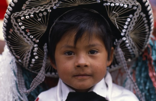 Stock Photo: 1850-24265 Mexico, Puebla, Huejotzingo, Head And Shoulders Portrait Of Young Boy Dressed For Carnival.