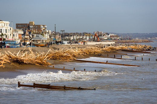 Stock Photo: 1850-24436 England, West Sussex, Worthing, Timber Washed Up On The Beach From The Greek Registered Ice Princess Which Sank Off The Dorset Coast On 15Th January 2008. Wood Sits Above The High Water Mark Beyond The Groynes In Front Of Seafront Buildings