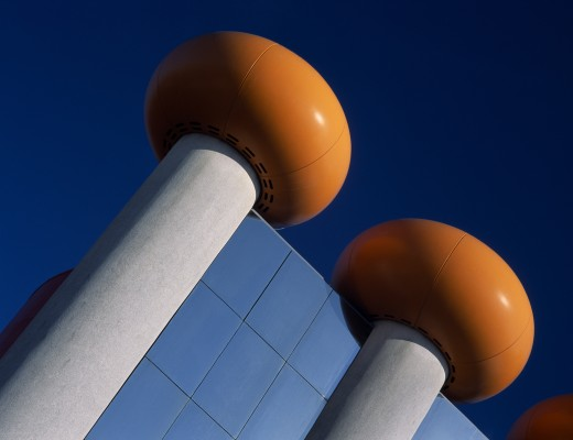 Holland, Noord Holland, Zandvoort, The Circus Building Amusement Arcade And Cinema Complex. Detail Of Modern Roof With Doughnut Shaped Orange Rings Against A Blue Sky : Stock Photo