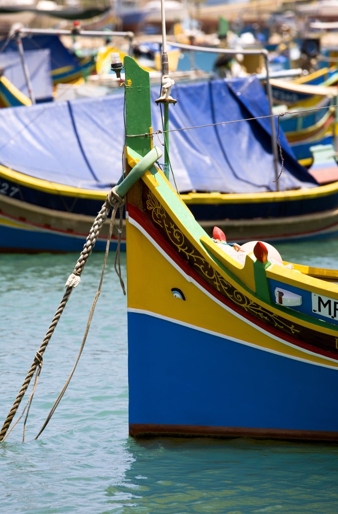 Malta, Marsaxlokk , Fishing Village Harbour On The South Coast With Colourful Kajjiki Fishing Boats With The Eyes Of Osiris On The Bow : Stock Photo