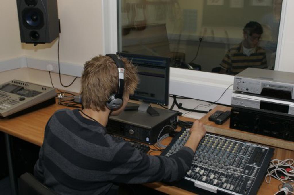 Stock Photo: 1850-25090 Children, Education, Secondary, Students Using Sound Desk In School Recording Studio.